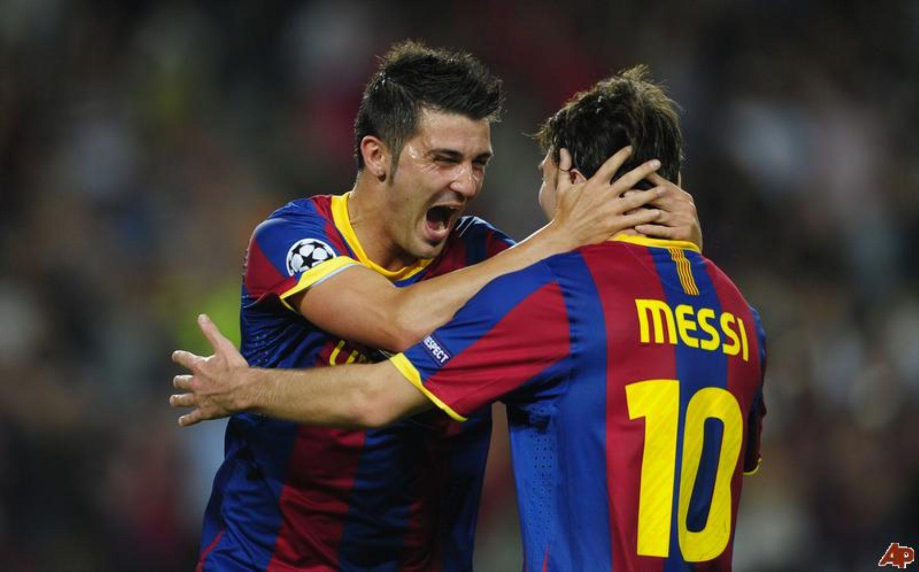 David Villa y Lionel Messi celebran el triunfo de Barcelona.