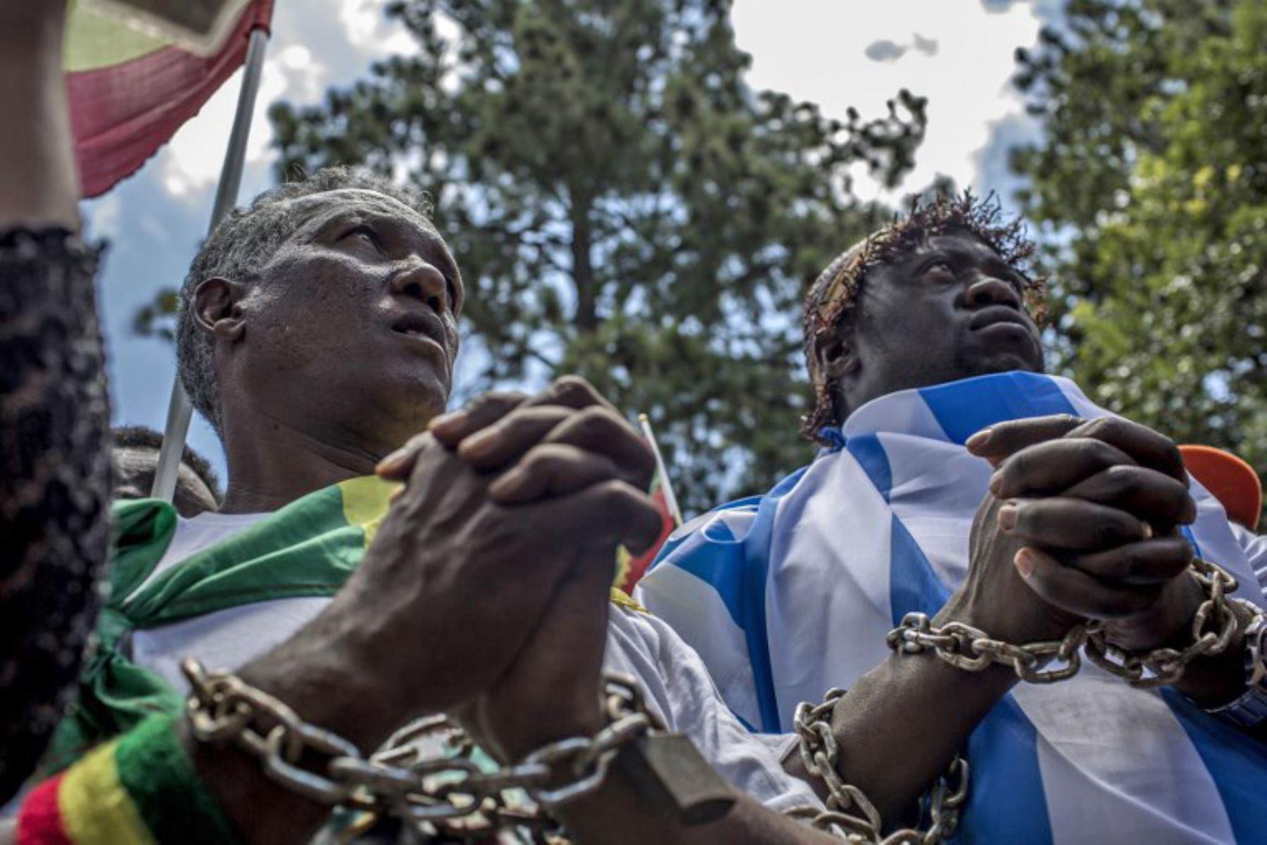 Manifestación contra la trata de esclavos y el tráfico de personas en Libia. Foto: AFP