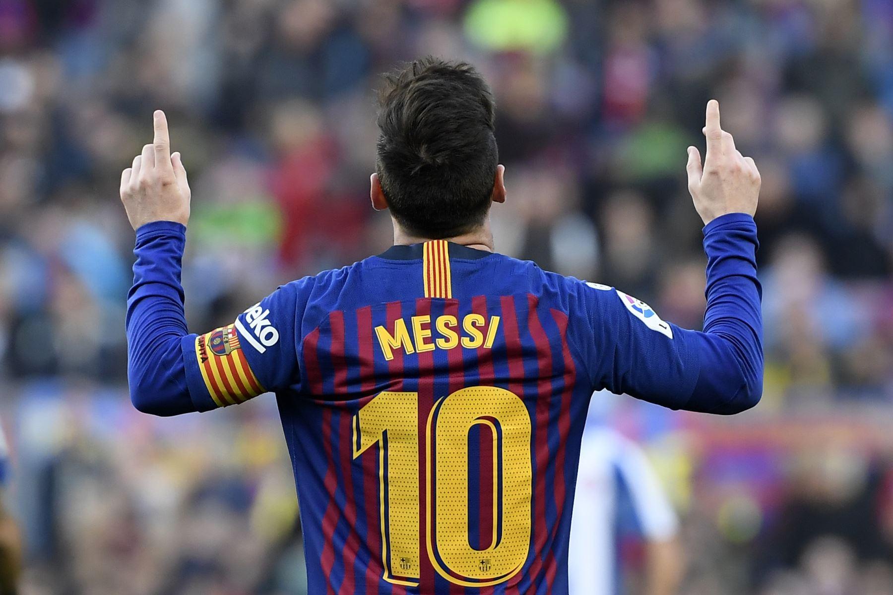 El delantero argentino de Barcelona, Lionel Messi, celebra su segundo gol durante el partido de fútbol de la liga española entre el FC Barcelona y el RCD Espanyol.Foto: AFP