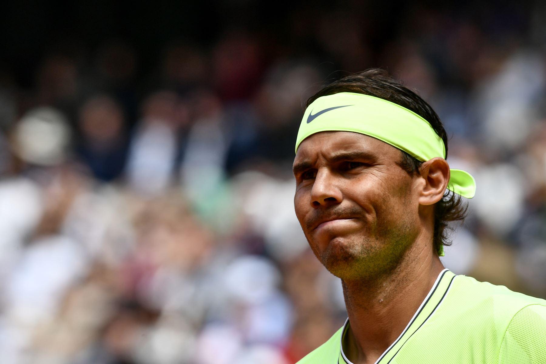 El español Rafael Nadal reacciona cuando ingresa a la cancha de tenis antes del partido final de individuales masculino contra el dominic Thiem de Austria del torneo de tenis Roland Garros 2019. Foto:AFP