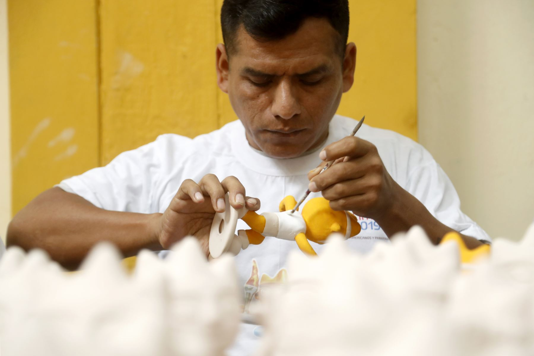 20 Internos del penal de Lurigancho elaboraron en cerámica la mascota oficial MILCO de los Juegos Panamericanos 2019, los cuales se venderan en 6 sedes del evento deportivo. Foto: ANDINA/Josue Ramos