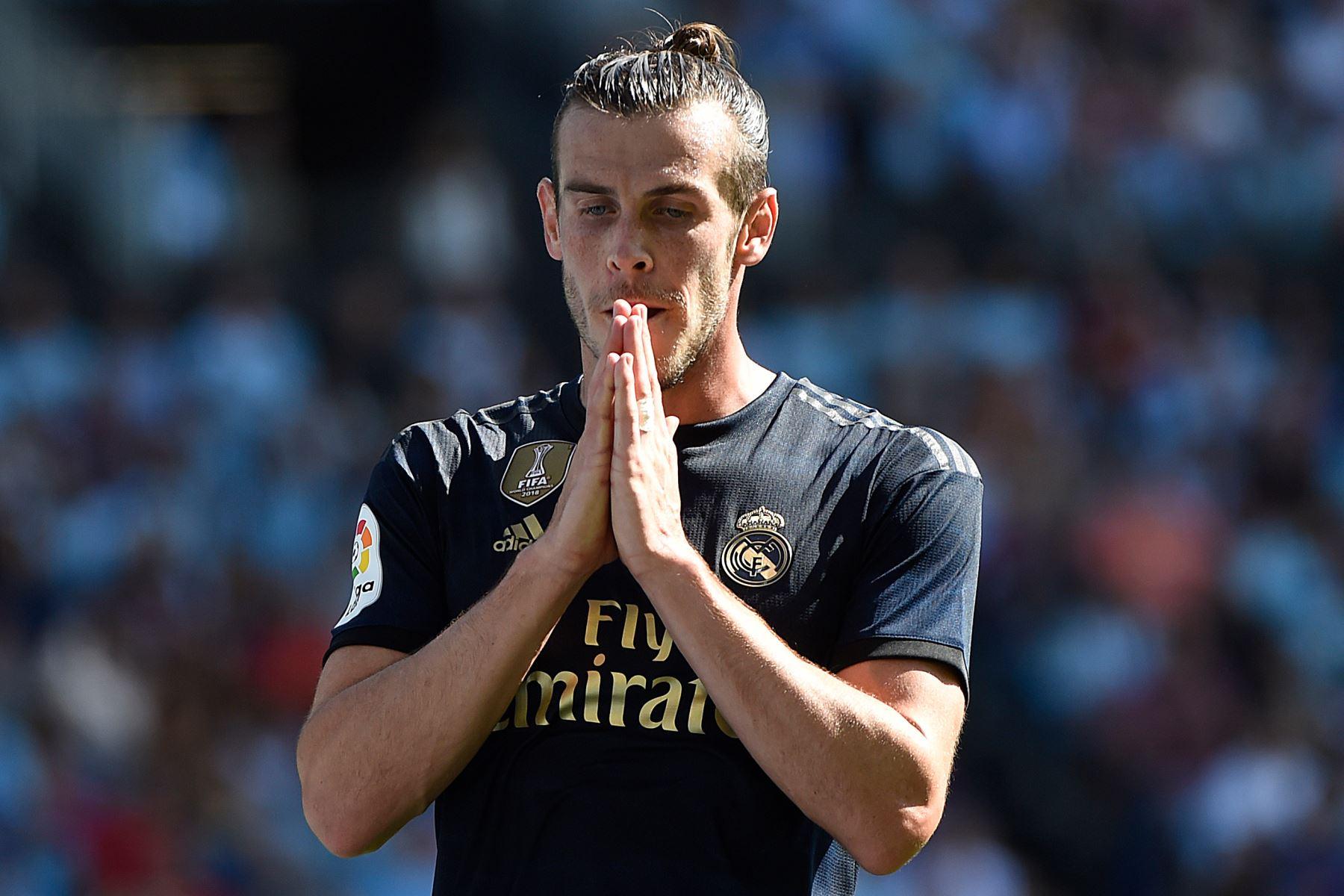El delantero galés del Real Madrid, Gareth Bale, reacciona después de perder una oportunidad de gol durante el partido de fútbol de la Liga española entre el Celta Vigo y el Real Madrid. Foto:AFP